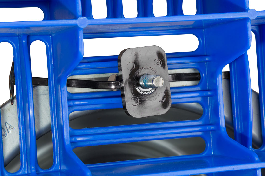 The Hog Slat flooring fastener features a bolt nut encased in a plastic square with tabs. The nut assembly slides between the floor openings and can be adjusted with the tabs that keep it from falling through the floor. The bolt assembly can then be attached for secure placement of an AquaBowl or other equipment. The plastic tabs can be cut off after installation.